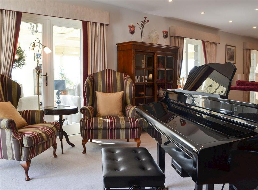 Living room with baby grand piano at Bodrydd,