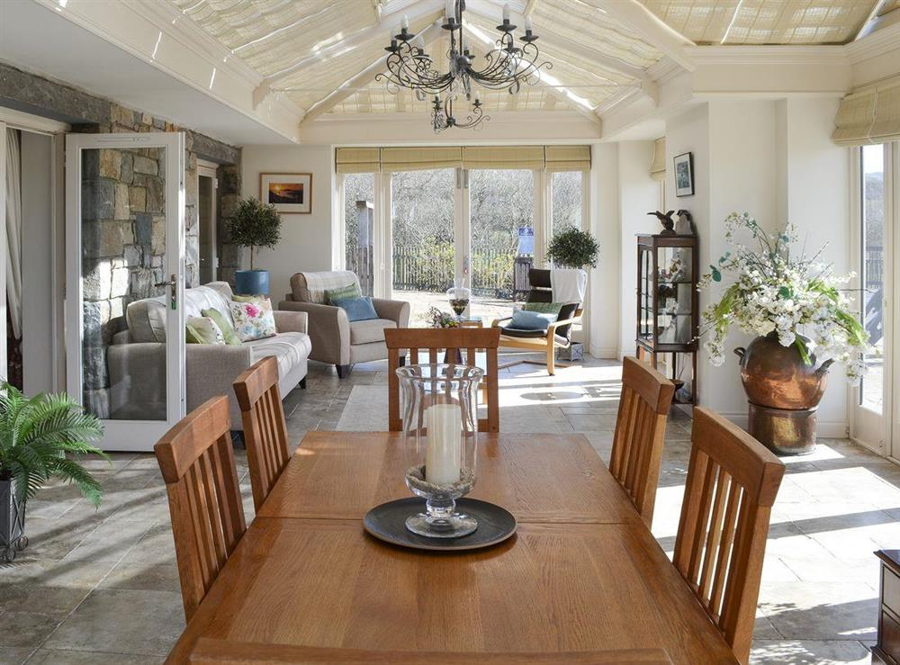 Spacious conservatory with dining area at Bodrydd,