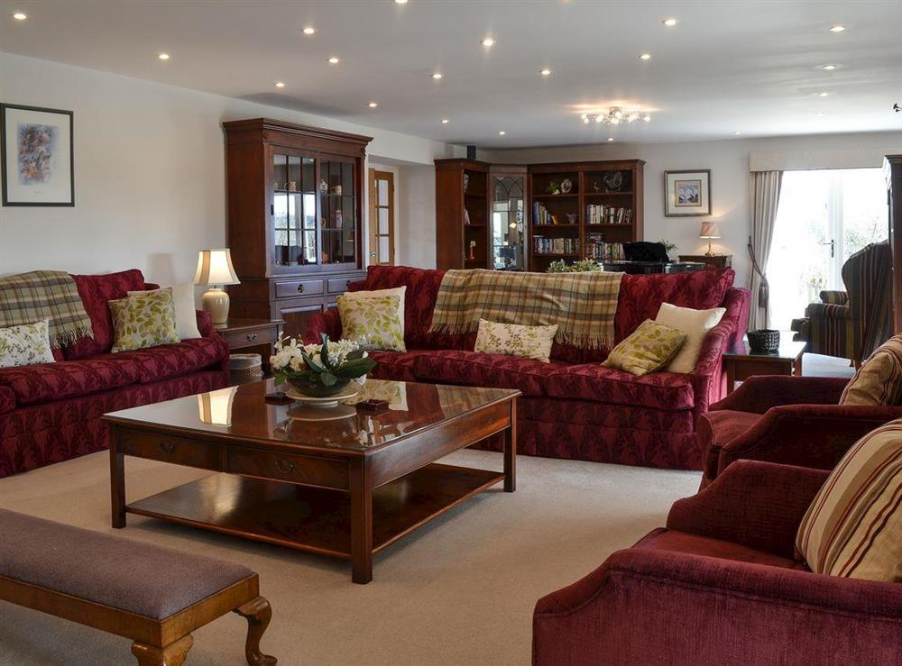 Spacious, thoughtfully furnished living room (photo 2) at Bodrydd,