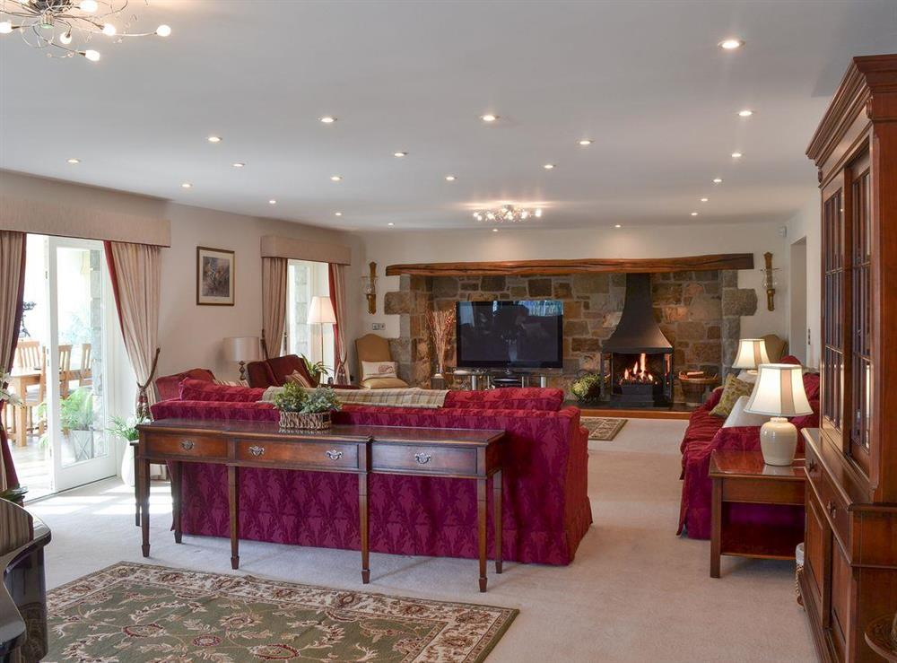 Spacious, thoughtfully furnished living room at Bodrydd,