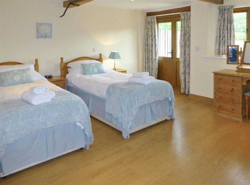 Light and airy twin bedroom at Great Coombe,