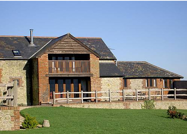 The outside of the cottage at Great Coombe,