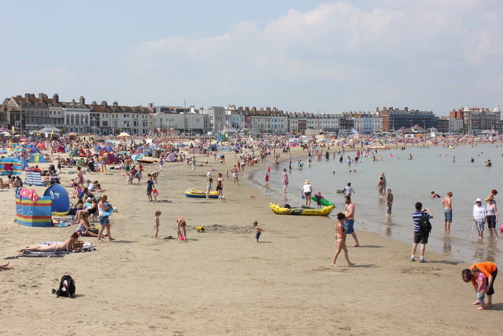 A busy day on Weymouth Beach at Great Coombe,