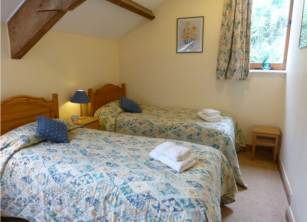 A twin bedroom at Little Coombe,