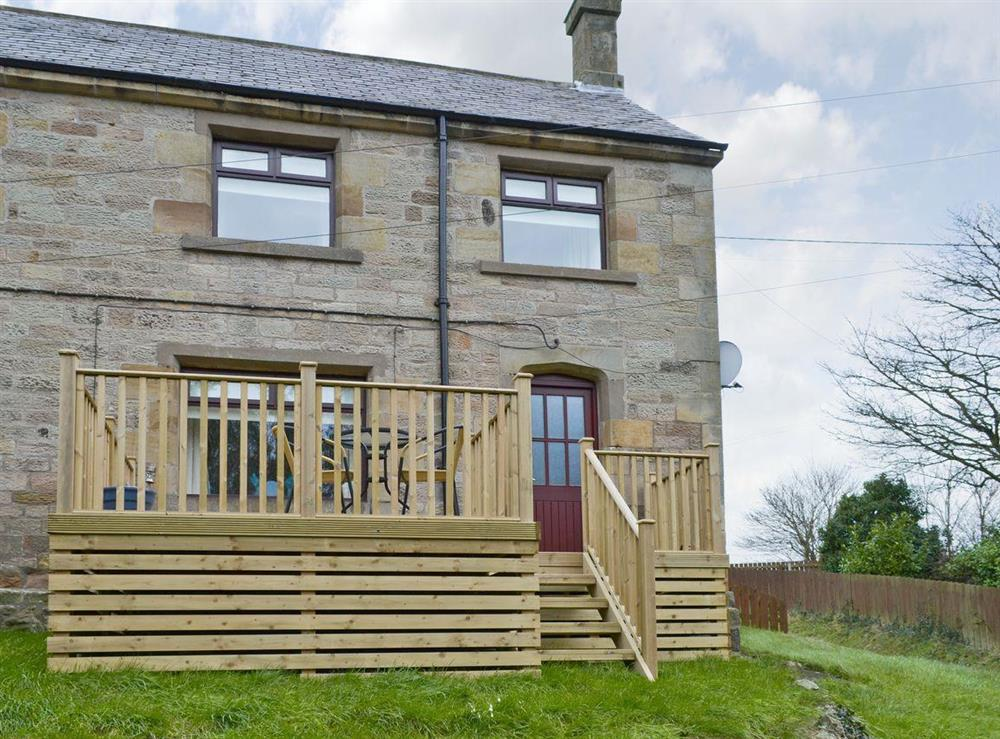 Attractive stone-built home with decked terrace at Tulip Cottage,