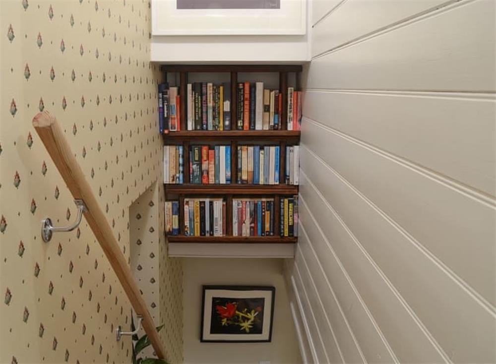 Stairway with bookshelves at Bramble Cottage in Horrabridge, near Tavistock, Devon