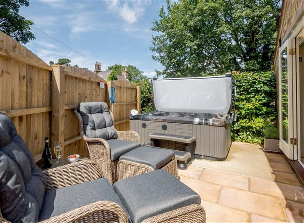 Delightful patio area with hot tub and outdoor furniture at The Chicken Coop,