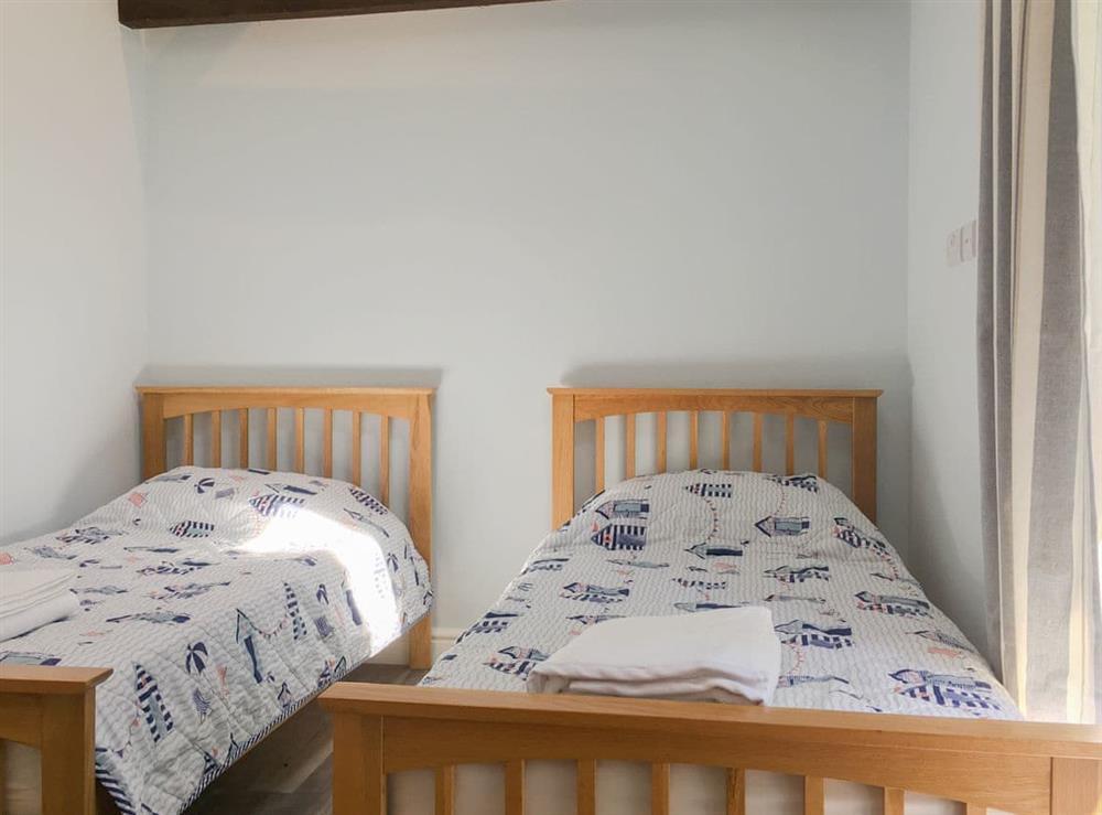 Twin bedroom at The Long Barn,