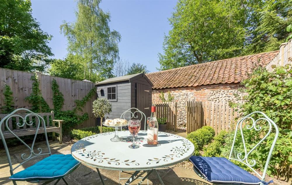 Enjoy the warmer months in the enclosed rear courtyard garden at Bridge Cottage at Bridge Cottage, Aylsham