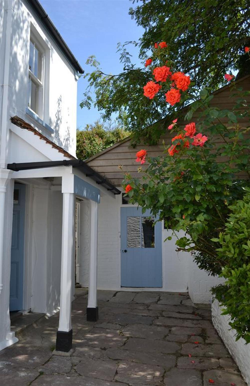 Front door and the enclosed courtyard at Britannia Cottage, Stoke Fleming