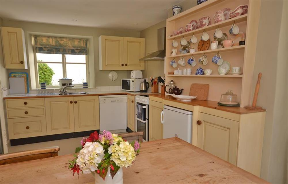 Kitchen with dining area at Britannia Cottage, Stoke Fleming