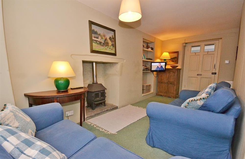 The comfortable sitting room with woodburner effect gas fire at Britannia Cottage, Stoke Fleming