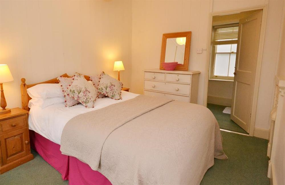 The double bedroom.with views over the garden and village at Britannia Cottage, Stoke Fleming
