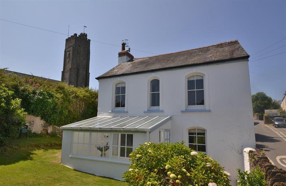View of exterior with nearby church tower at Britannia Cottage, Stoke Fleming