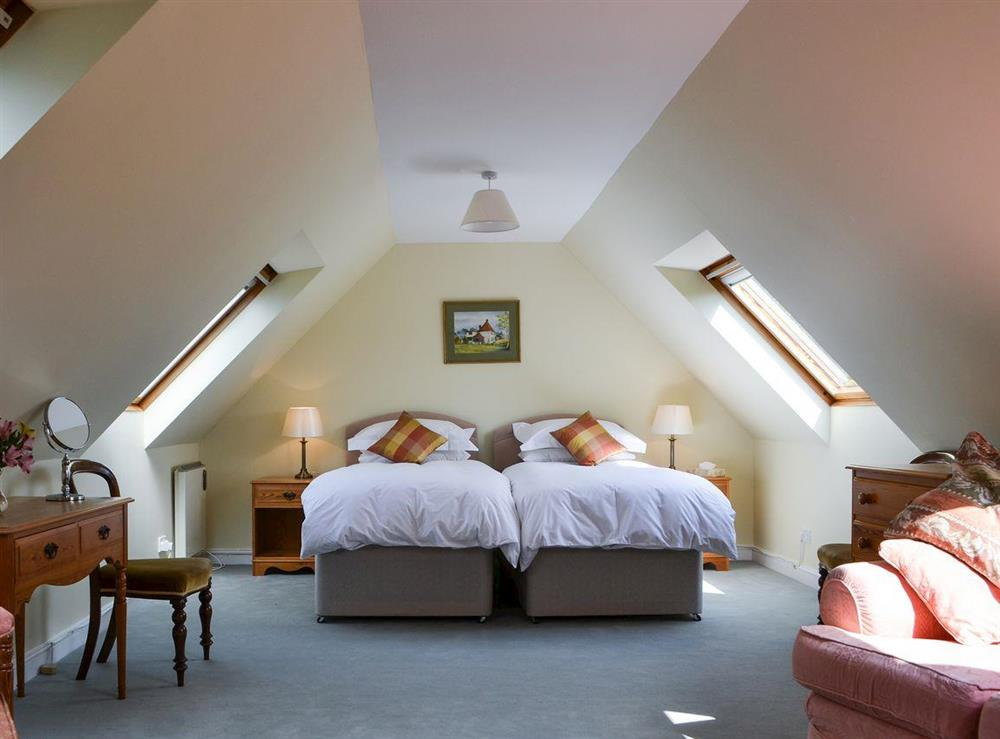 Living Room / bedroom with twin beds at Broad Cottage Boathouse in Ranworth, near Wroxham, Norfolk