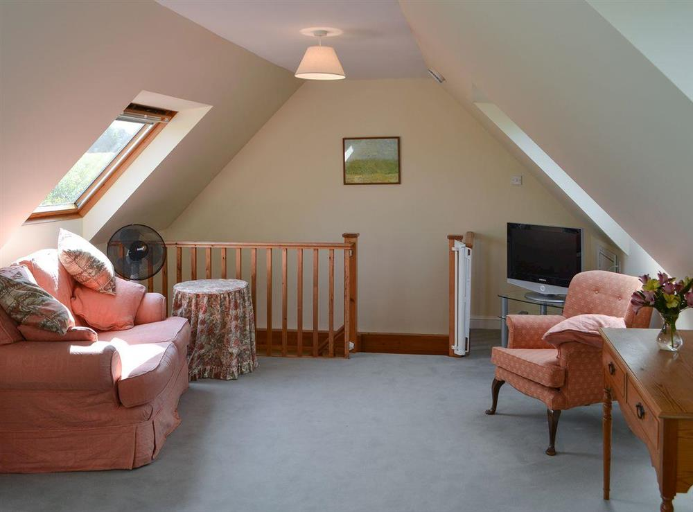 Living room/ bedroom at Broad Cottage Boathouse in Ranworth, near Wroxham, Norfolk