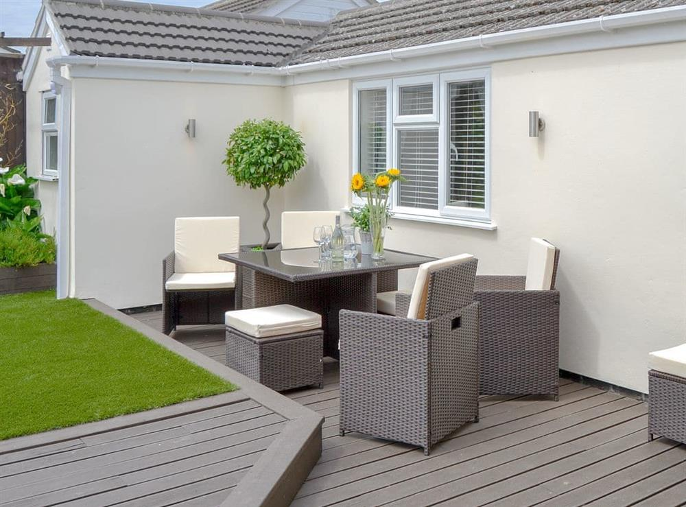 Decked area with sitting out furniture at Broadland Hideaway in Martham, near Great Yarmouth, Norfolk