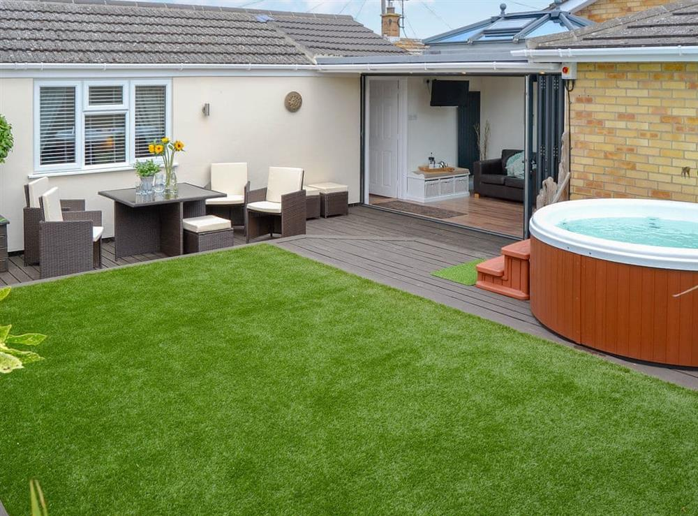 Delightful enclosed garden with private hot tub and sitting out area at Broadland Hideaway in Martham, near Great Yarmouth, Norfolk