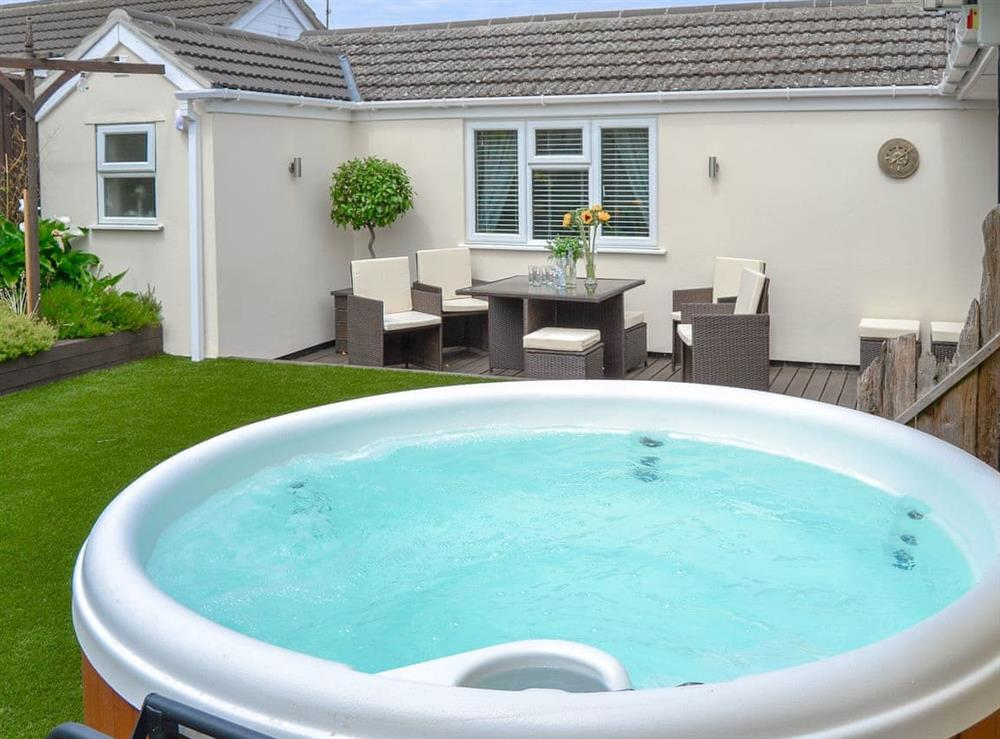 Delightful garden with private hot tub at Broadland Hideaway in Martham, near Great Yarmouth, Norfolk