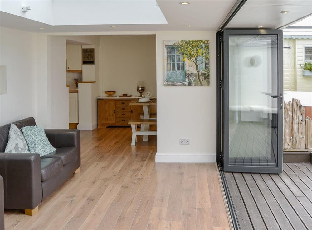 Light and airy sun room with bi-fold doors into the garden (photo 2) at Broadland Hideaway in Martham, near Great Yarmouth, Norfolk