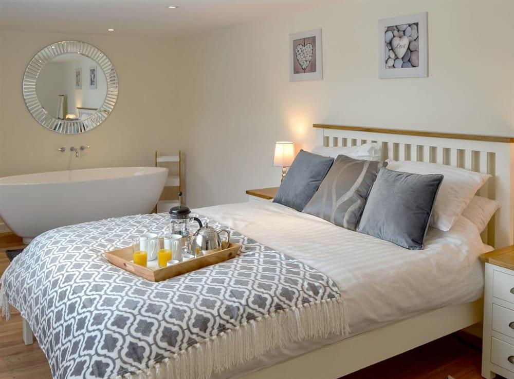 Romantic double bedroom with free standing bath at Broadland Hideaway in Martham, near Great Yarmouth, Norfolk