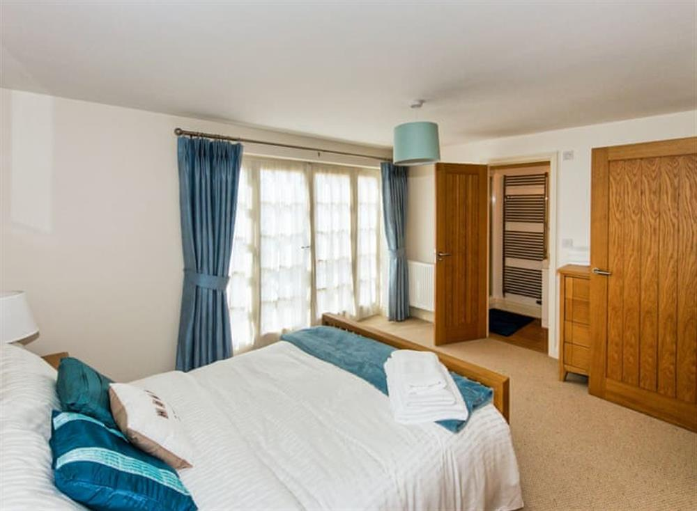 Master bedroom with en-suite at Broads Reach in Stalham Staithe, near Happisburgh, Norfolk