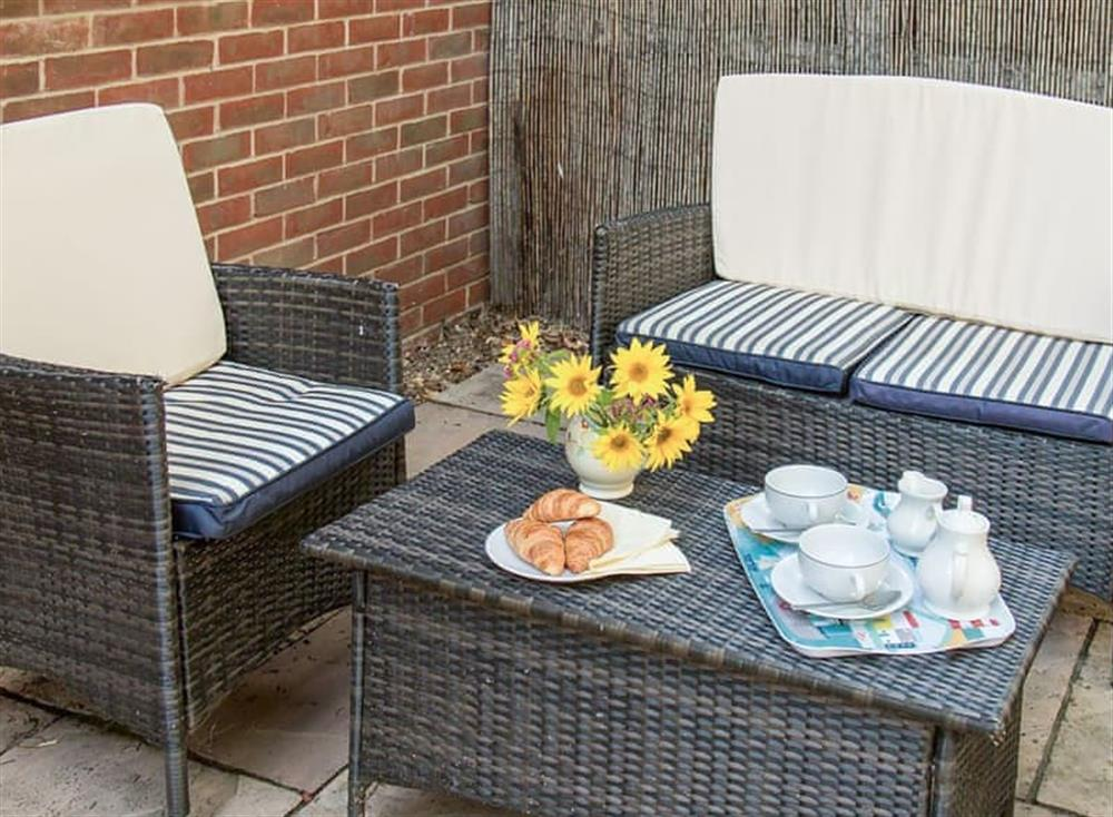 Peaceful patio, perfect for relaxing in the sunshine at Broads Reach in Stalham Staithe, near Happisburgh, Norfolk