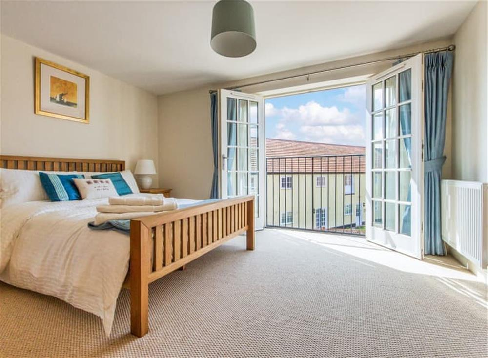 Spacious bedroom with Juliette balcony at Broads Reach in Stalham Staithe, near Happisburgh, Norfolk