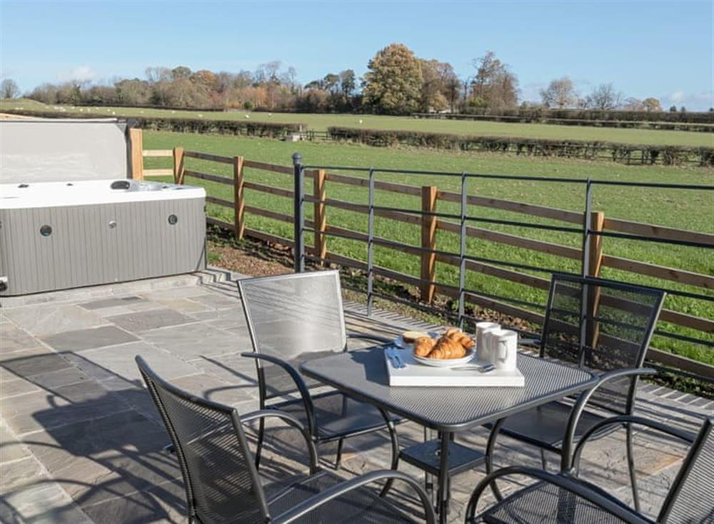 Enclosed private patio area with hot tub at The Hideaway,