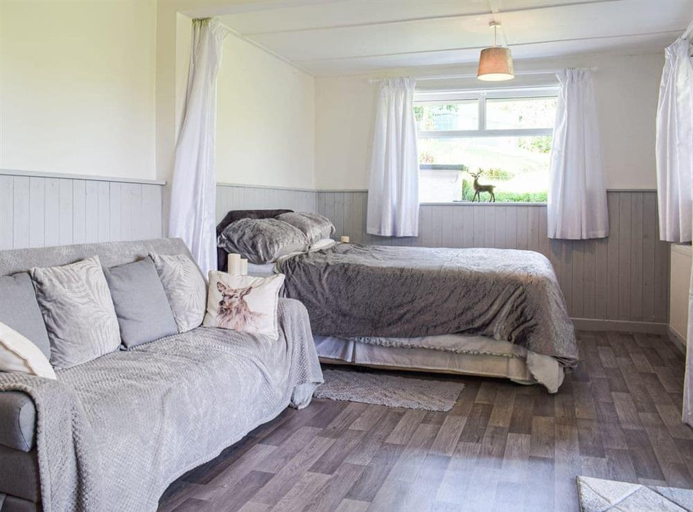 Open plan living space at Brookview Lodge in Blakeney, Gloucestershire