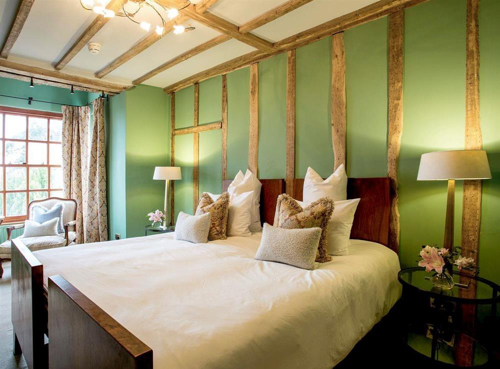 Luxurious double bedroom packed with heritage features at Bryn Tanat in Llansantffraid-ym-Mechain, near Oswestry, Powys