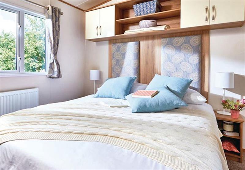 Bedroom in a Luxury caravan at Bucklegrove Holiday Park in Cheddar, Somerset