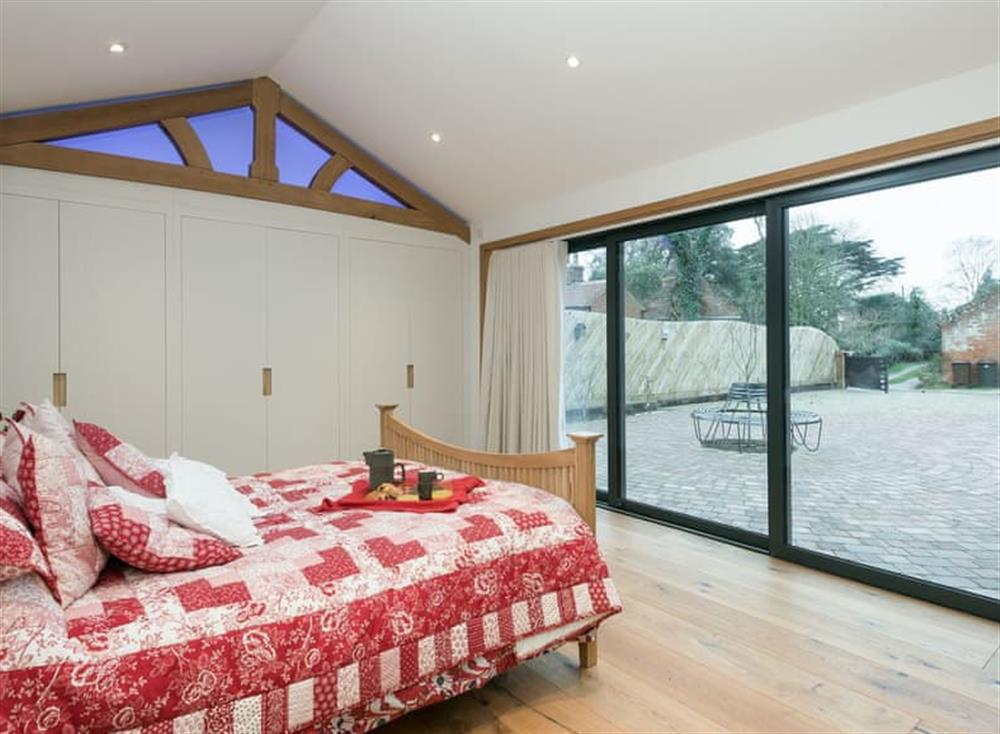 Double bedroom with bi-folding doors (photo 2) at Bumblebee Cottage in Geldeston, near Beccles, Norfolk