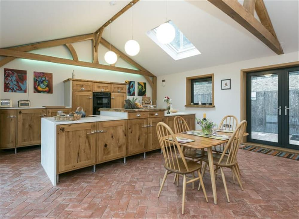Kitchen and dining area at Bumblebee Cottage in Geldeston, near Beccles, Norfolk