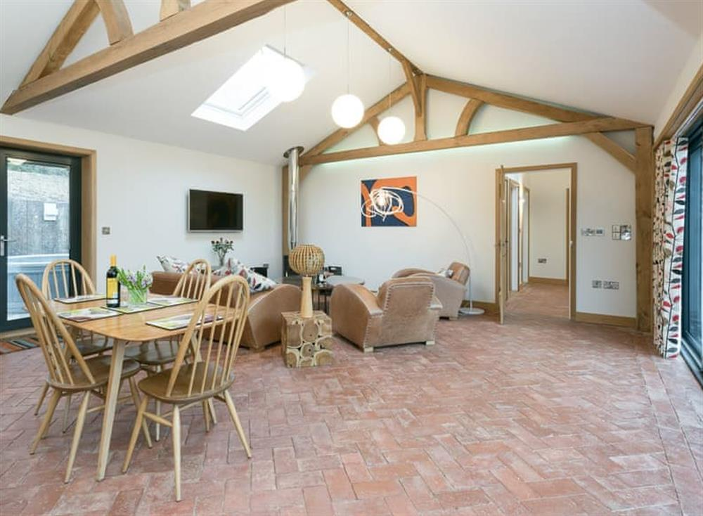 Open plan living space with bi-folding doors leading to garden (photo 2) at Bumblebee Cottage in Geldeston, near Beccles, Norfolk