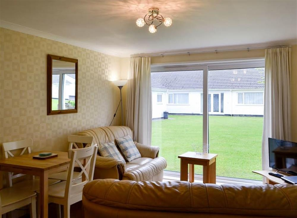 Open plan living space at Bungalow 56 in Scunage, near Reynoldston, Glamorgan, West Glamorgan