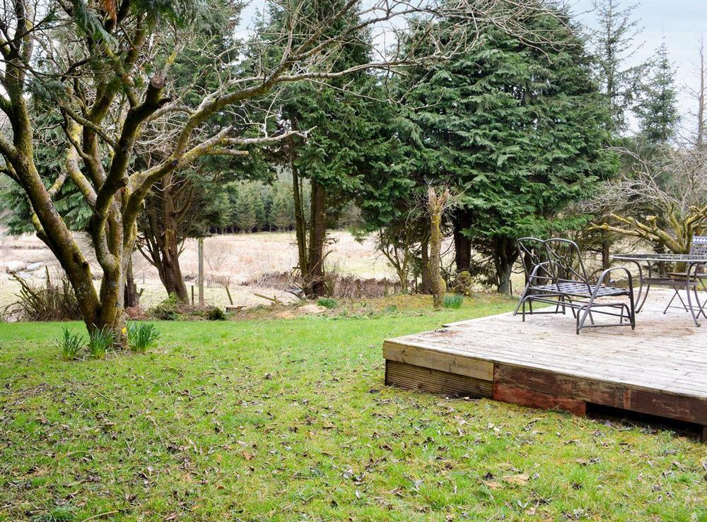 Enclosed lawned garden with sitting-out area and garden furniture (photo 2) at Burnside Cottage in Tormitchell, near Girvan, Ayrshire