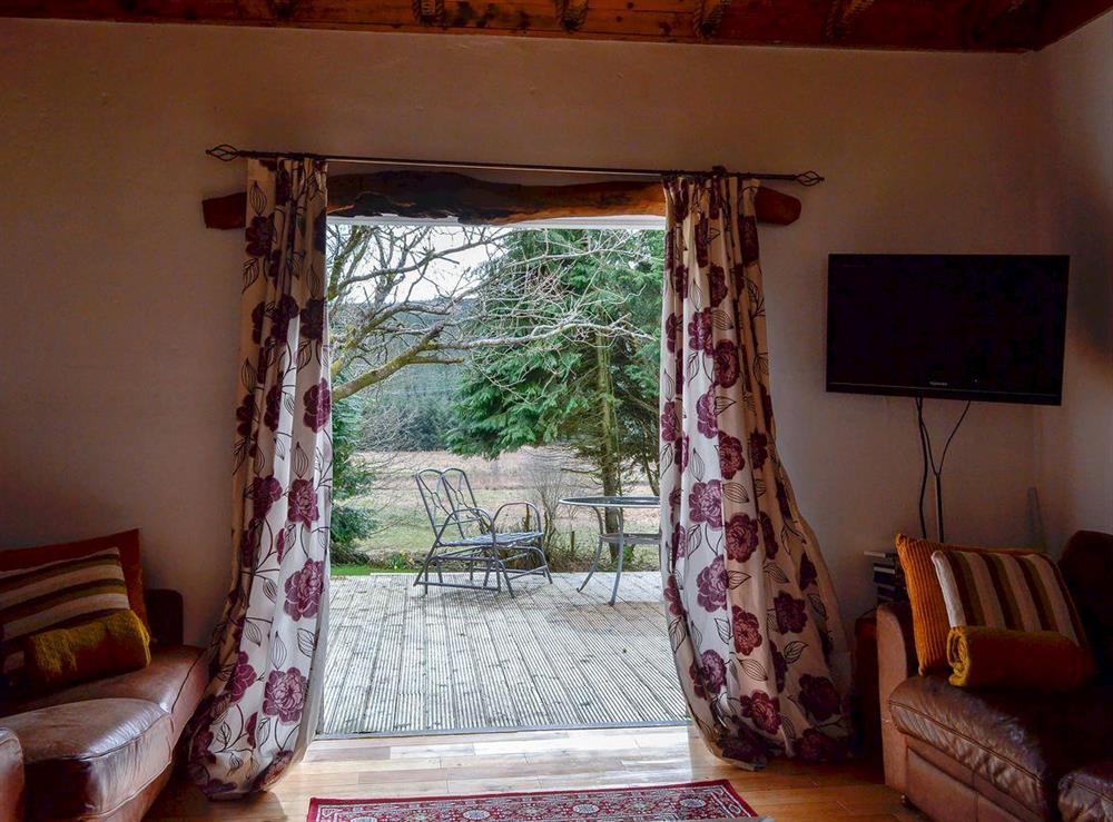 French doors leading to decked area at Burnside Cottage in Tormitchell, near Girvan, Ayrshire
