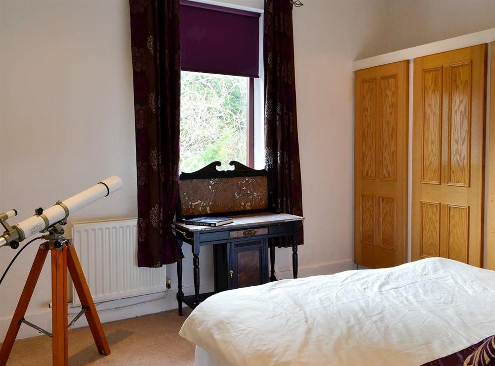 Relaxing bedroom with kingsize bed (photo 2) at Burnside Cottage in Tormitchell, near Girvan, Ayrshire