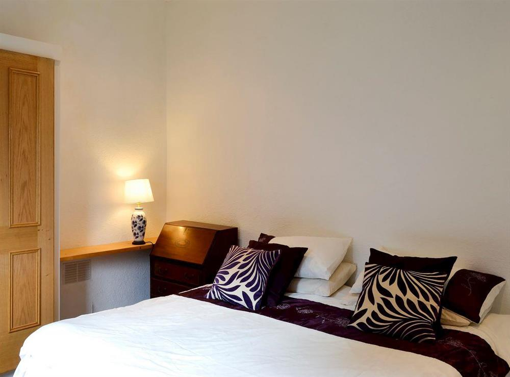 Relaxing bedroom with kingsize bed at Burnside Cottage in Tormitchell, near Girvan, Ayrshire