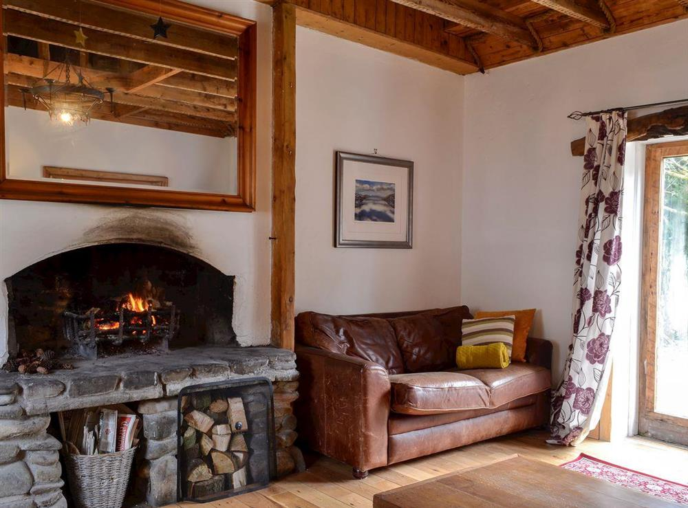 Rustic living room with open fire (photo 2) at Burnside Cottage in Tormitchell, near Girvan, Ayrshire