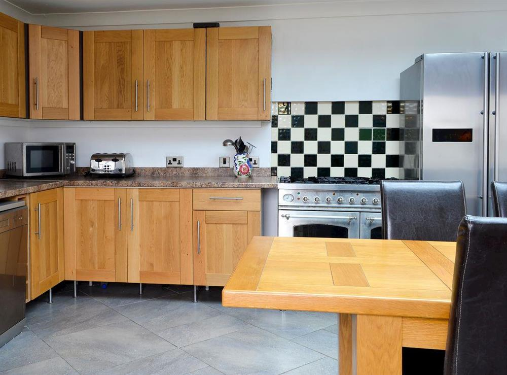 Spacious kitchen and dining area (photo 2) at Burnside Cottage in Tormitchell, near Girvan, Ayrshire