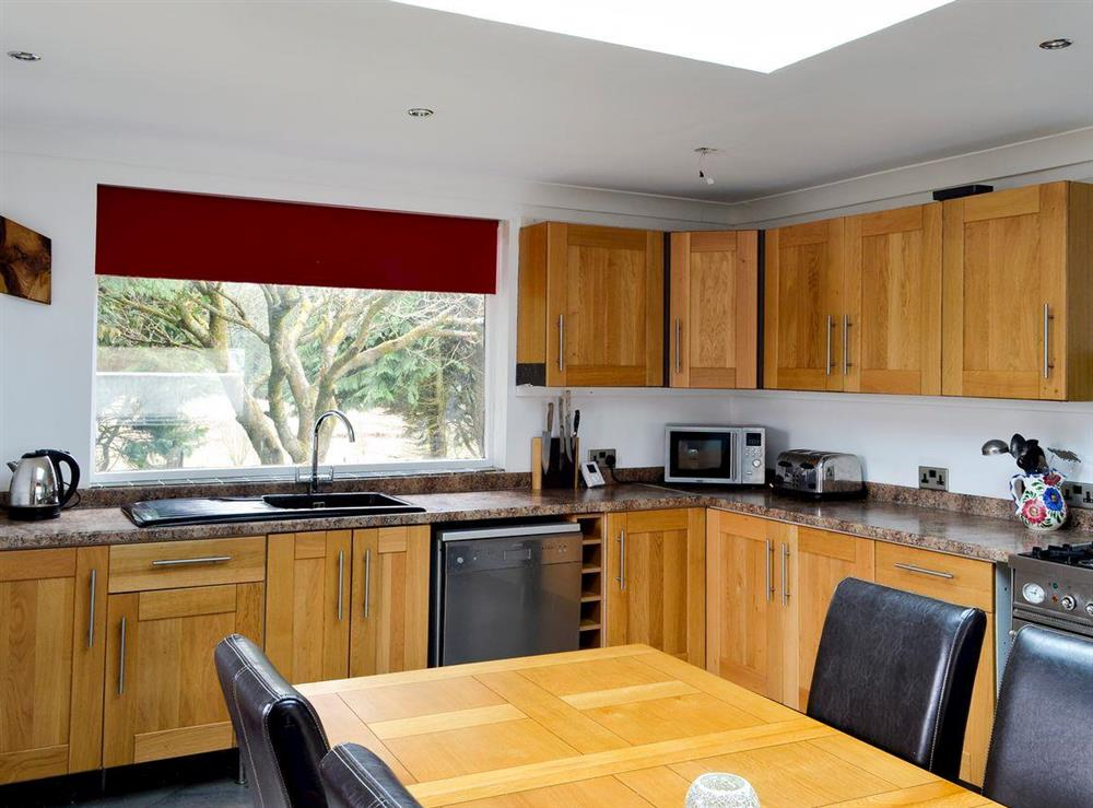 Spacious kitchen and dining area at Burnside Cottage in Tormitchell, near Girvan, Ayrshire