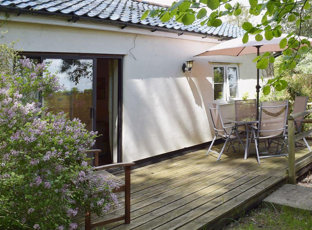 Decked patio with comfortable eating out area at Butter Pen in Denton, near Bungay, Norfolk