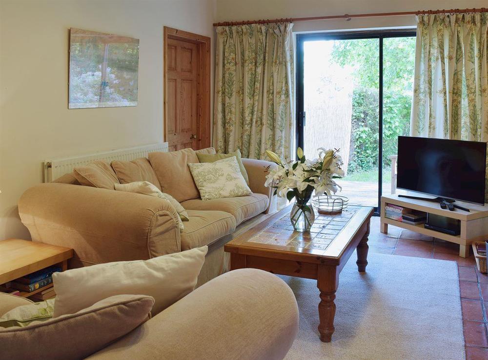 Open plan living area with tiled floor at Butter Pen in Denton, near Bungay, Norfolk