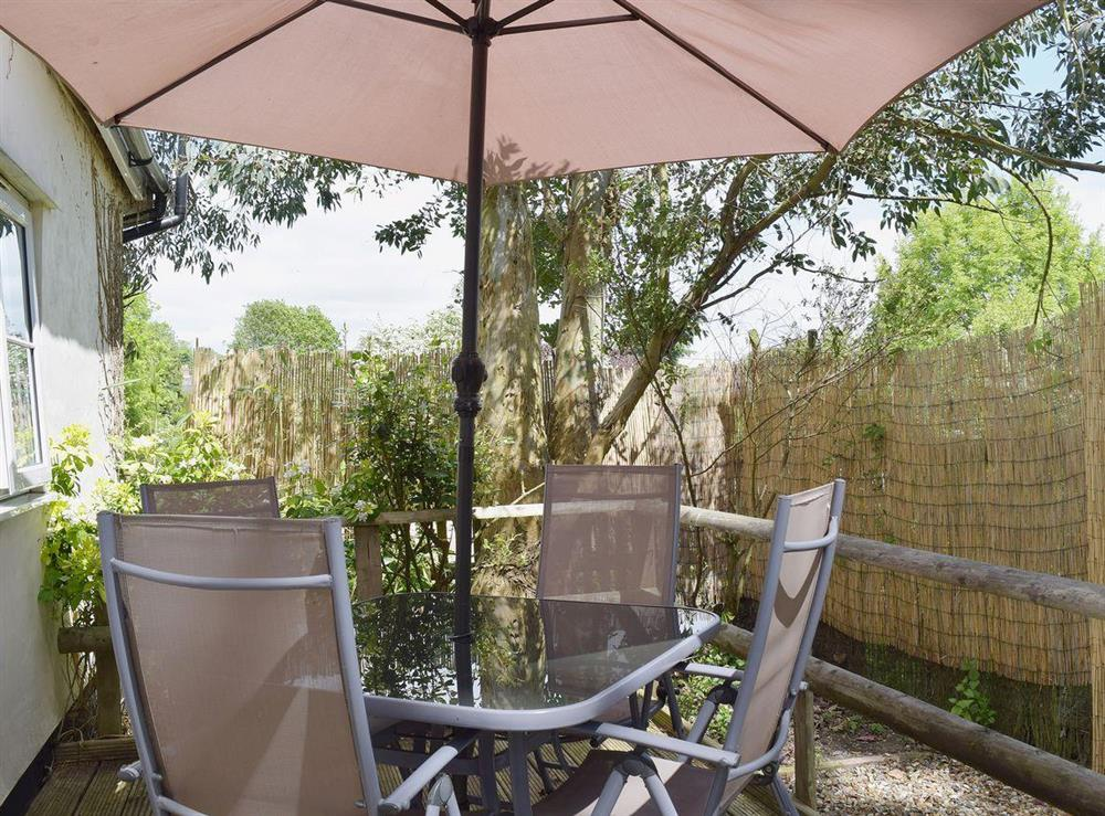 Shady sitting out area at Butter Pen in Denton, near Bungay, Norfolk