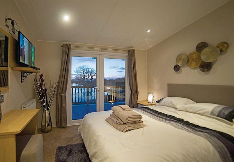 Bedroom in a Kingfisher at Caistor Lakes Lodges in Caistor, Market Rasen