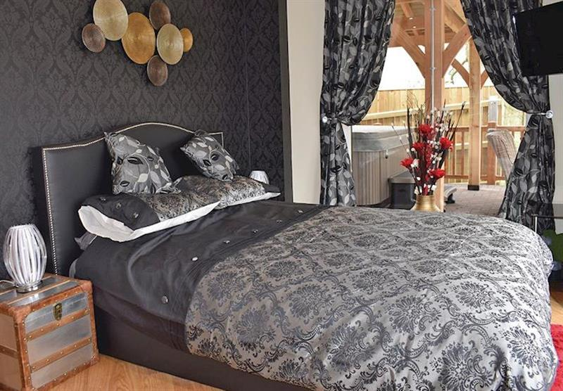 Bedroom in a Teal Lodge at Caistor Lakes Lodges in Caistor, Market Rasen