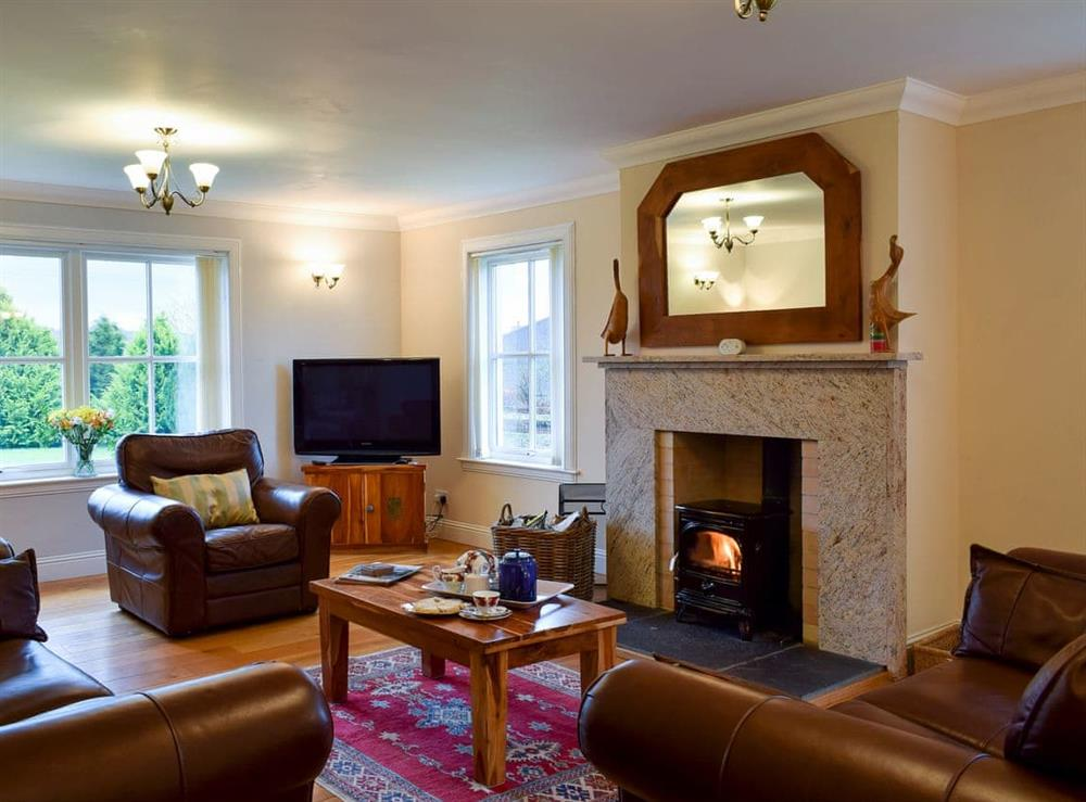 Comfortable living room with wood burner at Cambushinnie Croft in Cromlix, near Dunblane, Perthshire