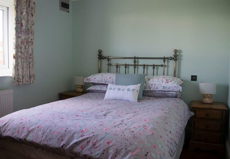 Double bedroom in the Lakeside Log Cabin at Camper UK Leisure Park in Swinethorpe, Nr Lincoln
